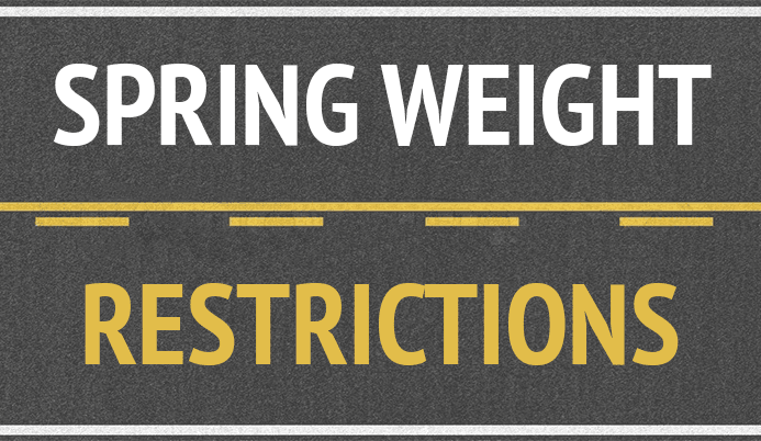Roadway with words &#39Spring Weight Restrictions&#39