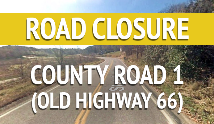 Roadway with words &#39Road Closure County Road 1 Old Highway 66&#39