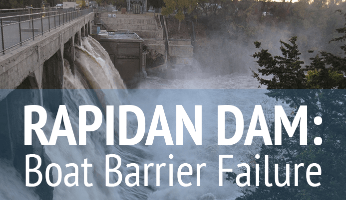 Rapidan Damn Boat Barrier Failure with flooding dam in background
