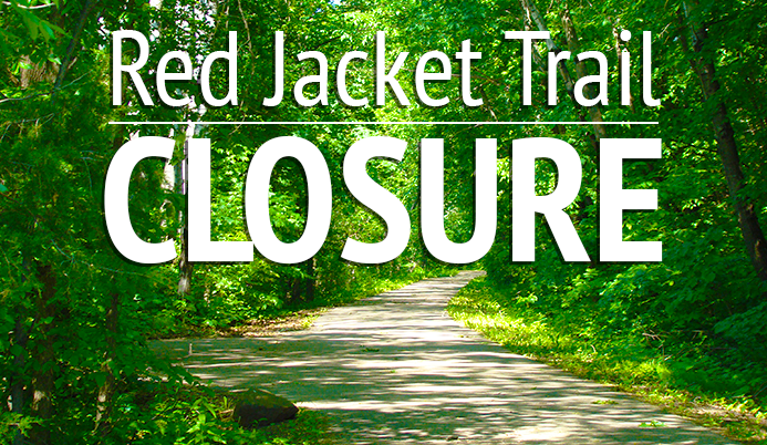 Wooded trail with text &#39red jacket trail closure&#39