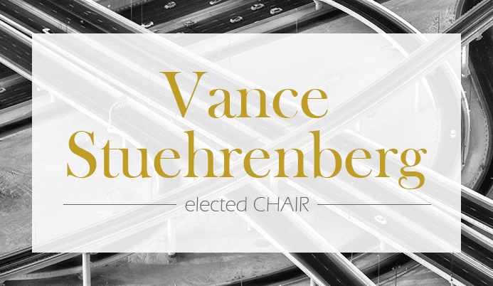 &#34Vance Stuehrenberg elected Chair&#34 text on top of black and white roadway intersections