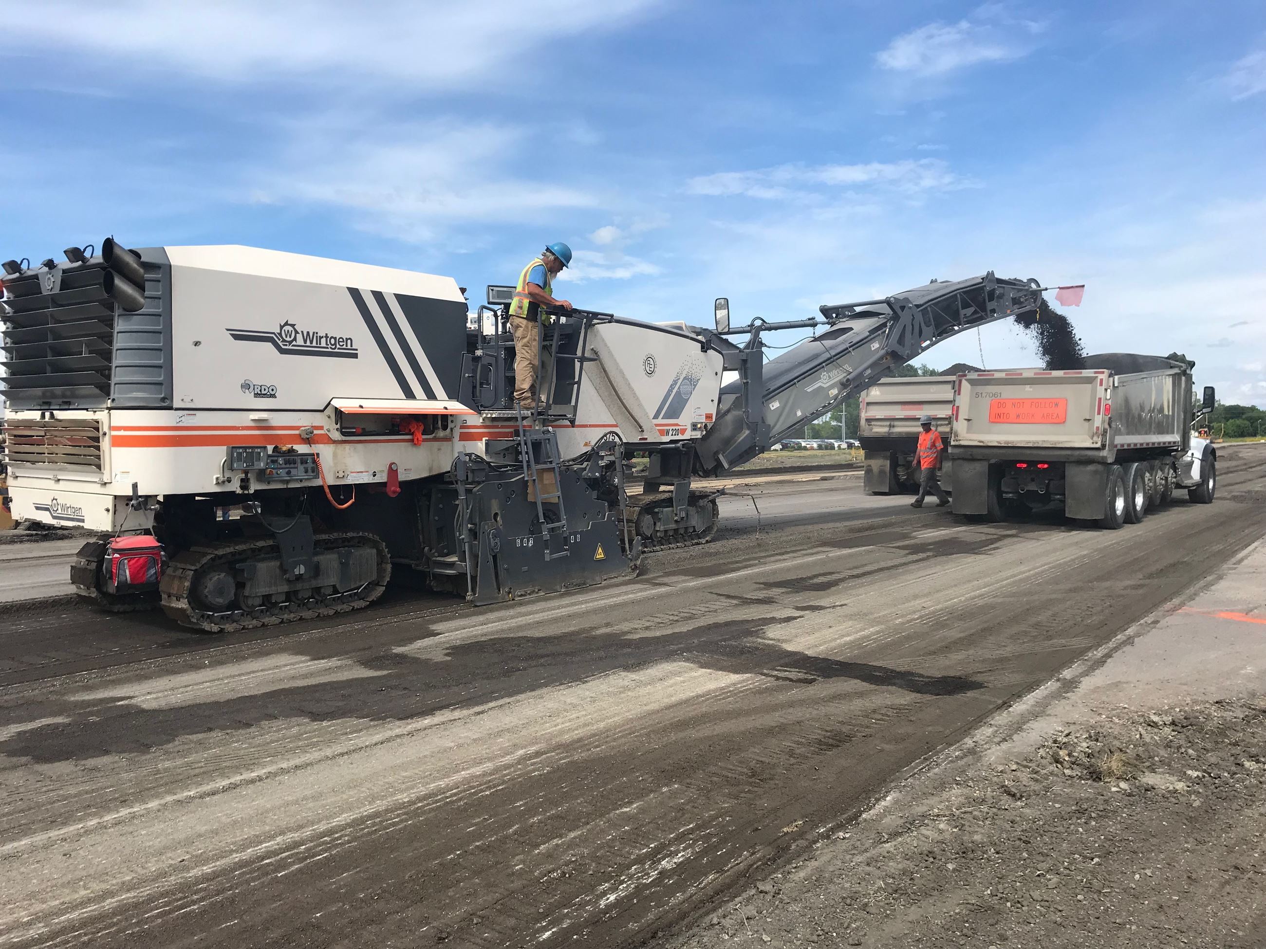Construction workers removing asphalt during road construction
