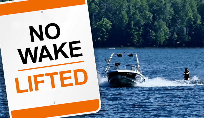 No Wake Lifted Sign, man water skiing behind boat