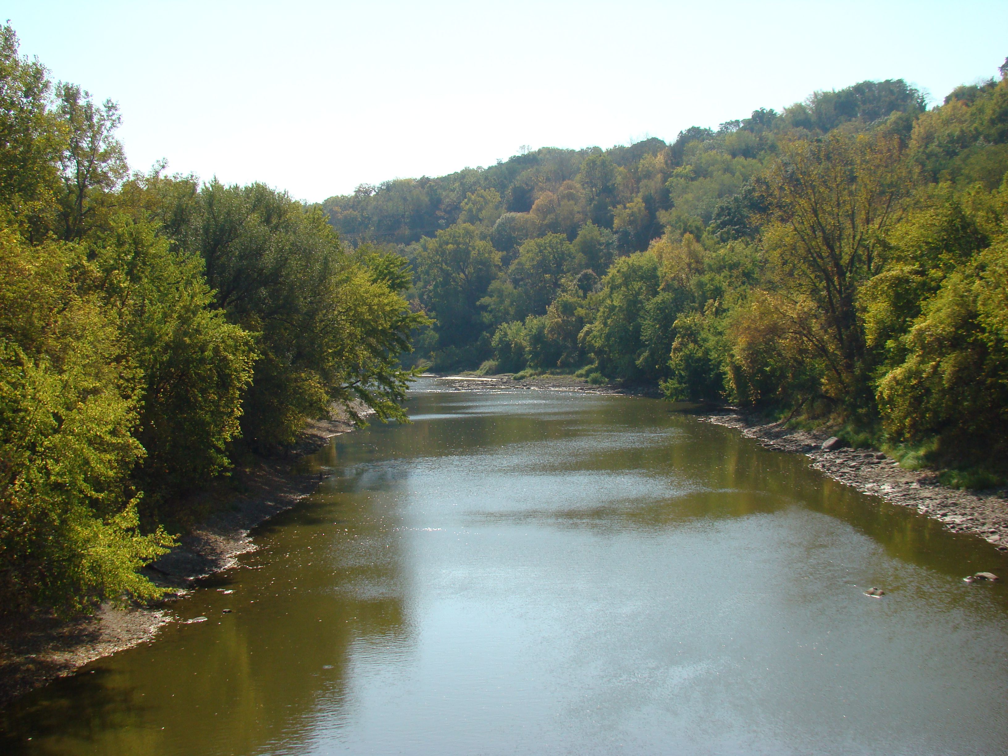 View of the Blue Earth River in early fall from a bridge.