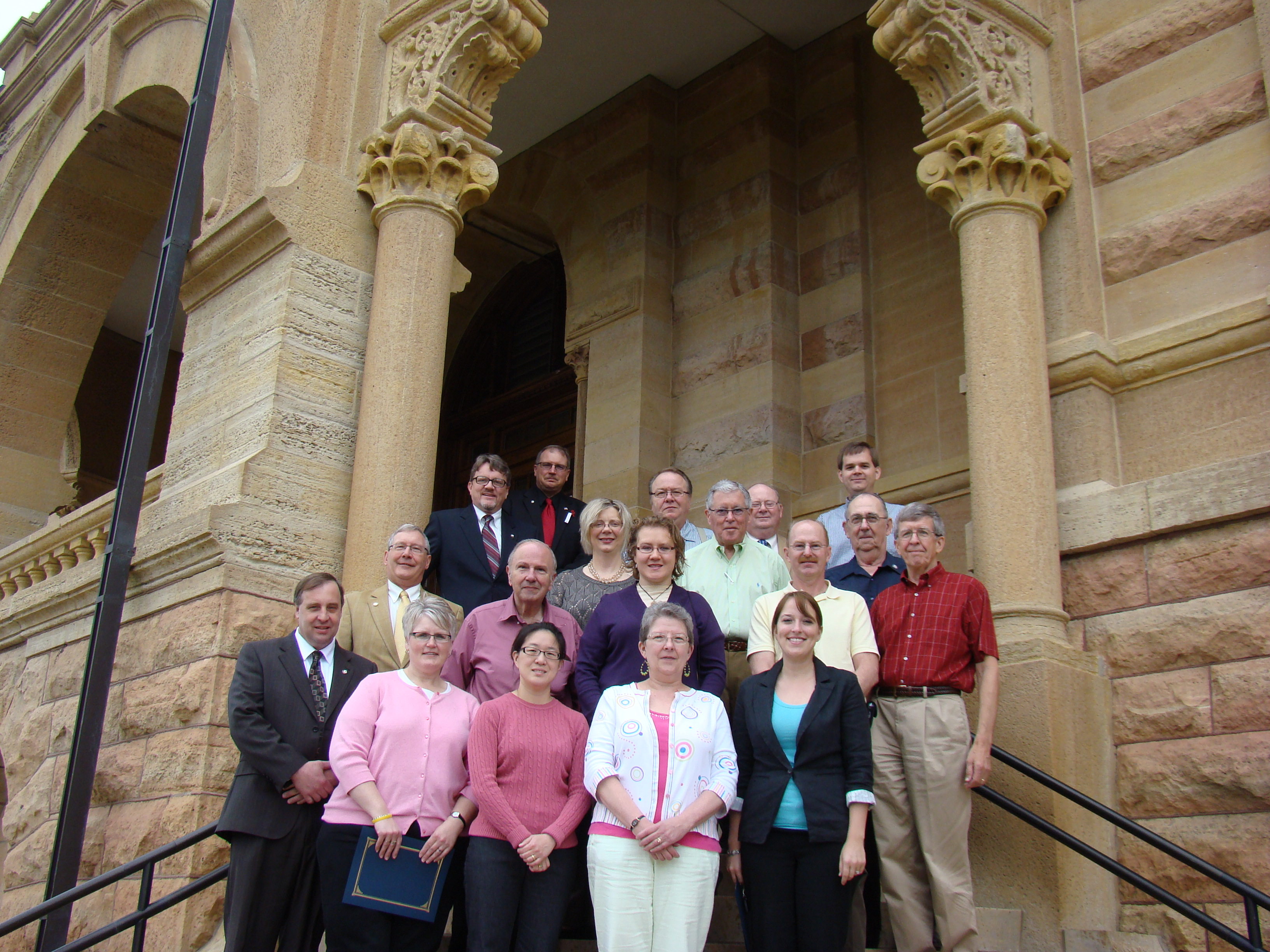 2012 graduates with the Board of Commissioners on the steps of the Historic Courthouse.