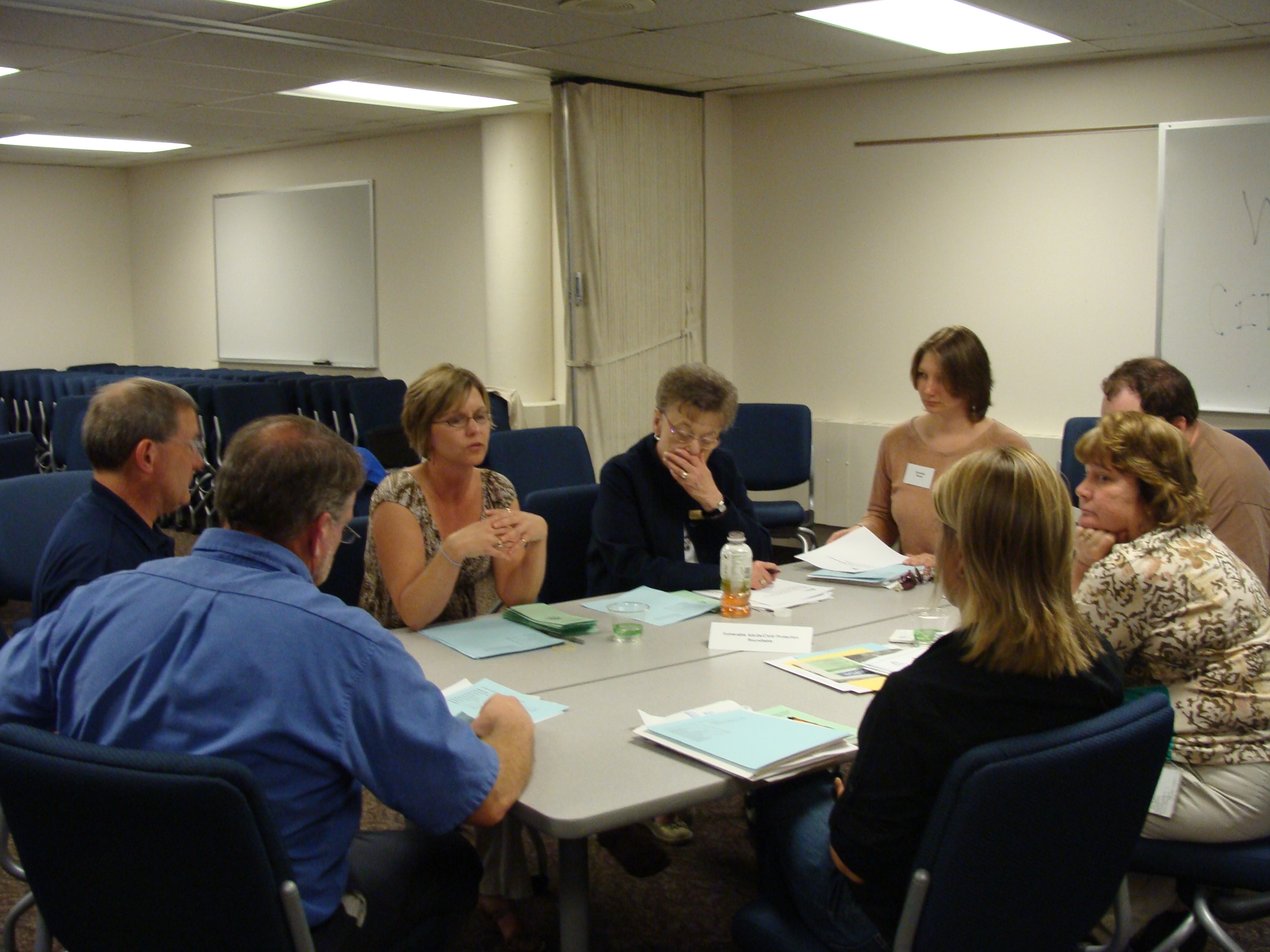 Participants discussing areas of the Human Services Department.
