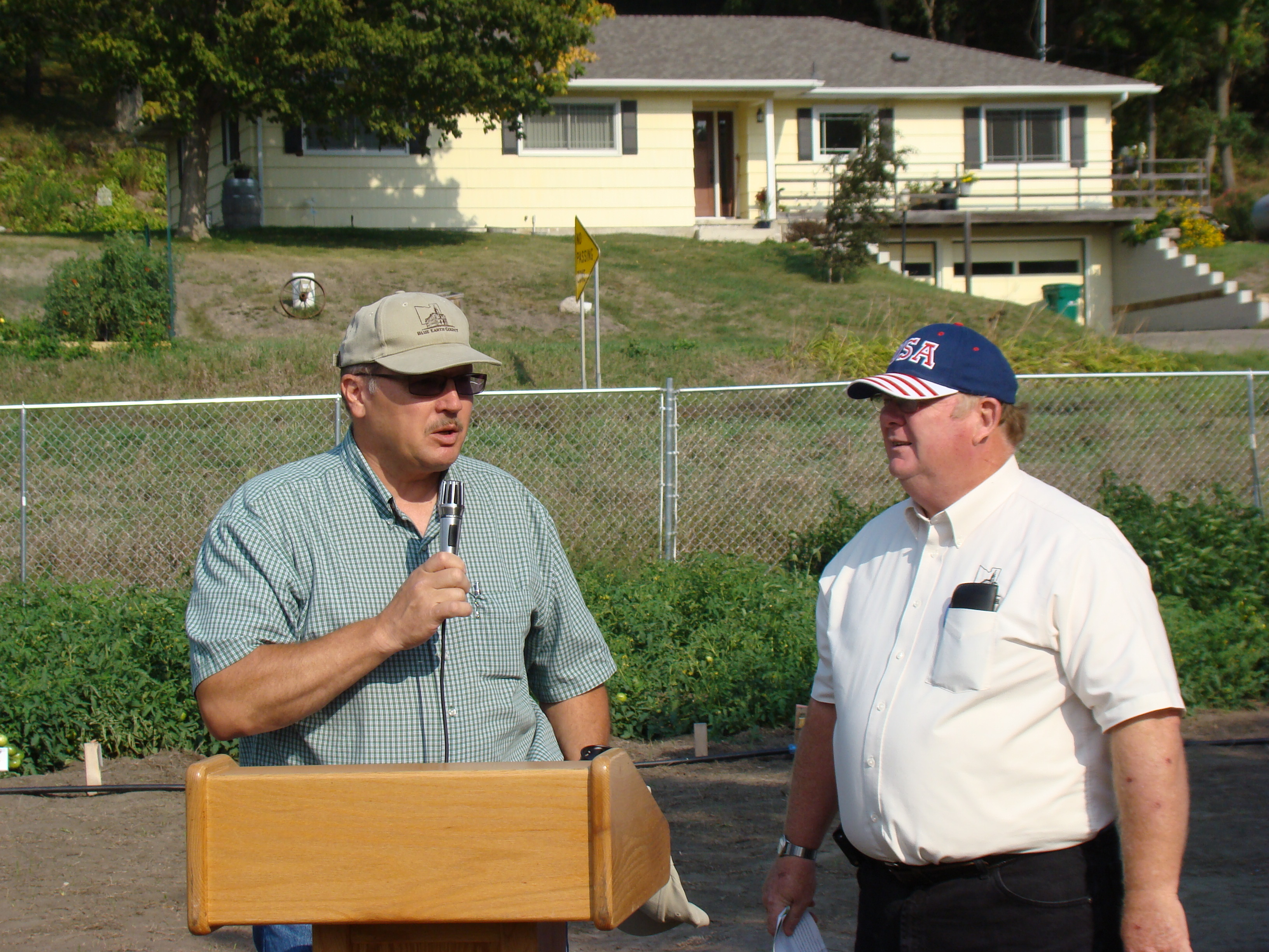Commissioners Vance Stuehrenberg and Will Purvis speaking at the Community Farm